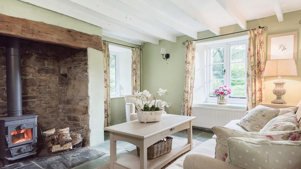 Sitting and dining room overlooks the stunning gardens, snuggle up next to the woodburner after a day exploring