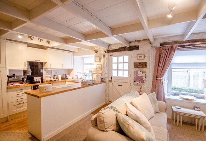 Step into the cosy open plan kitchen/living area.
