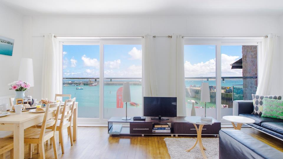 Light and airy living area with fantastic harbour views.