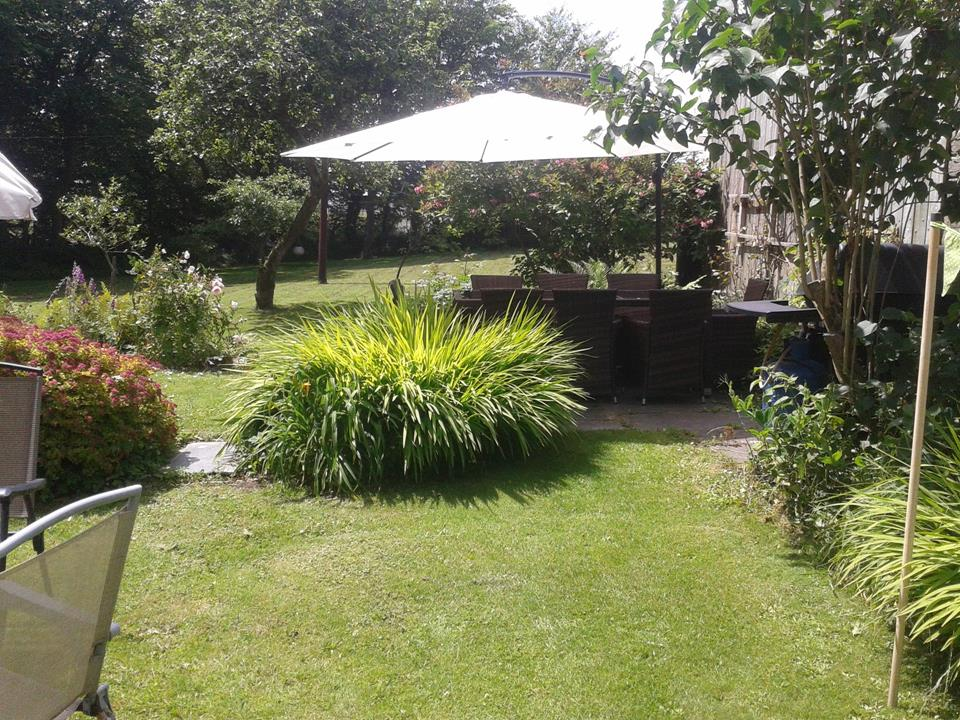 Spacious garden ideal for family games and relaxation.