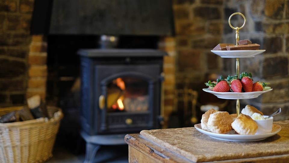 Relax with a classic Cornish cream tea in the cosy living room alongside the traditional wood burner.