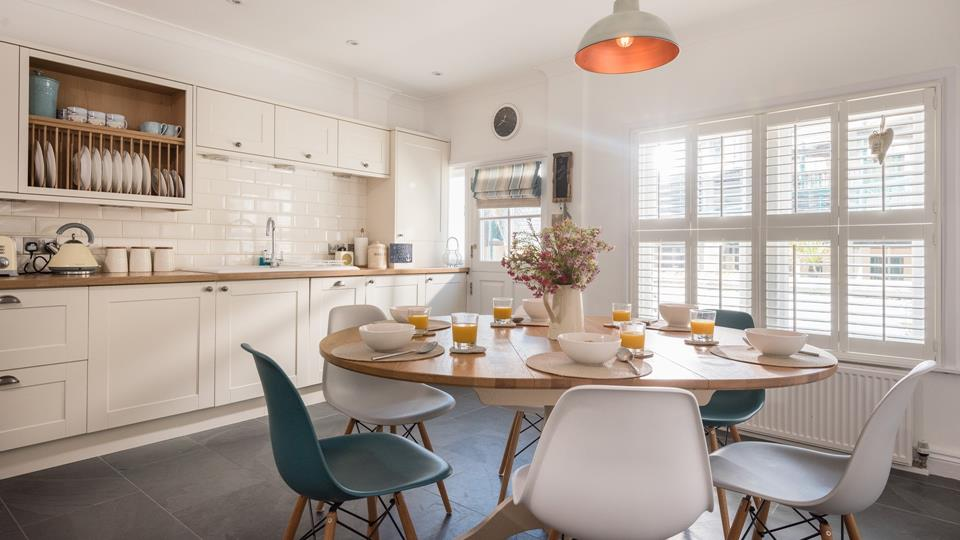 Beautiful country style kitchen with a round table is the perfect space for socialising.