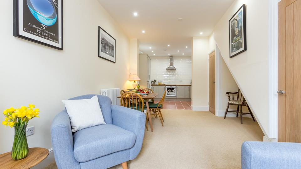 Following from the small entrance hallways into the open plan living/dining and kitchen area.