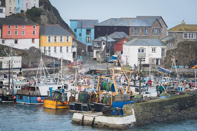 The Hideaway sits on the end of the quay in Mevagissey harbour.