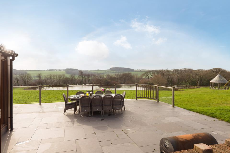 The large terrace that wraps around the living area, is an idyllic spot for enjoying a meal whilst the children make the most of the expansive of garden.