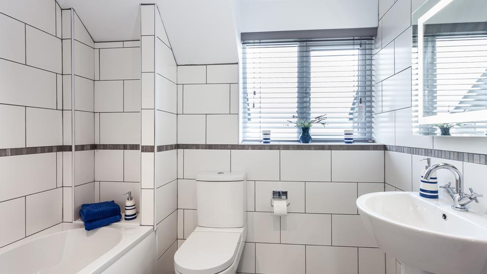 The family bathroom is bright and spacious with lots of room for the family.