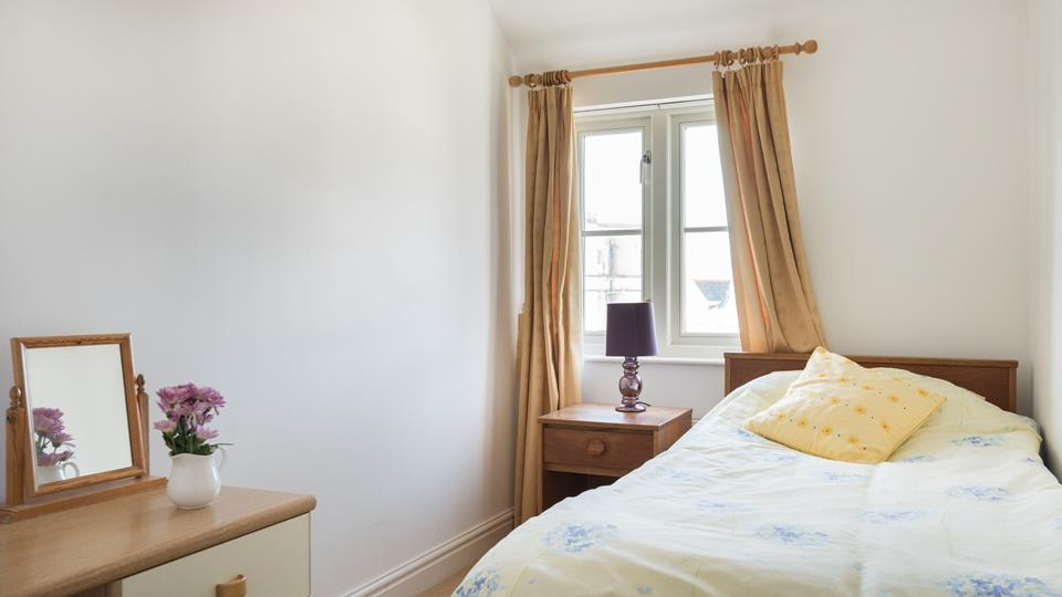 Sumptuous beds and cosy furnishings make this room the perfect place to snuggle down after a day exploring Newquay.