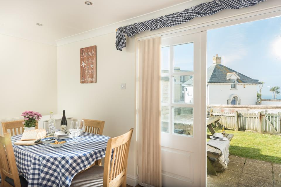 The kitchen/dining area has doors to the outside area so you can keep an eye on the children whilst you prepare for a day at the beach.