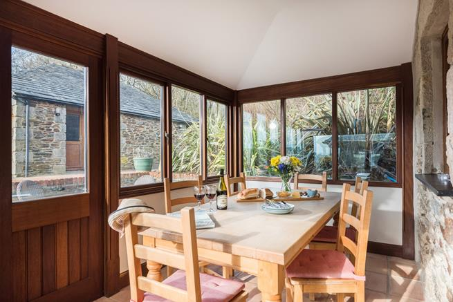 The spacious, sunny dining area with full height glazing, is a great spot for enjoying a good breakfast.