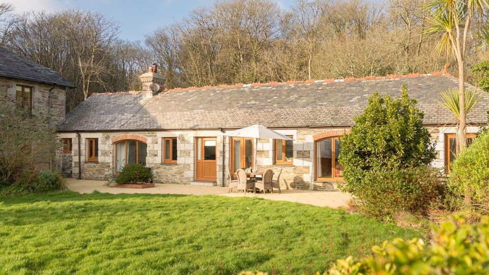 The Coach House is all on one level, with only one step outside into the enclosed gardens.