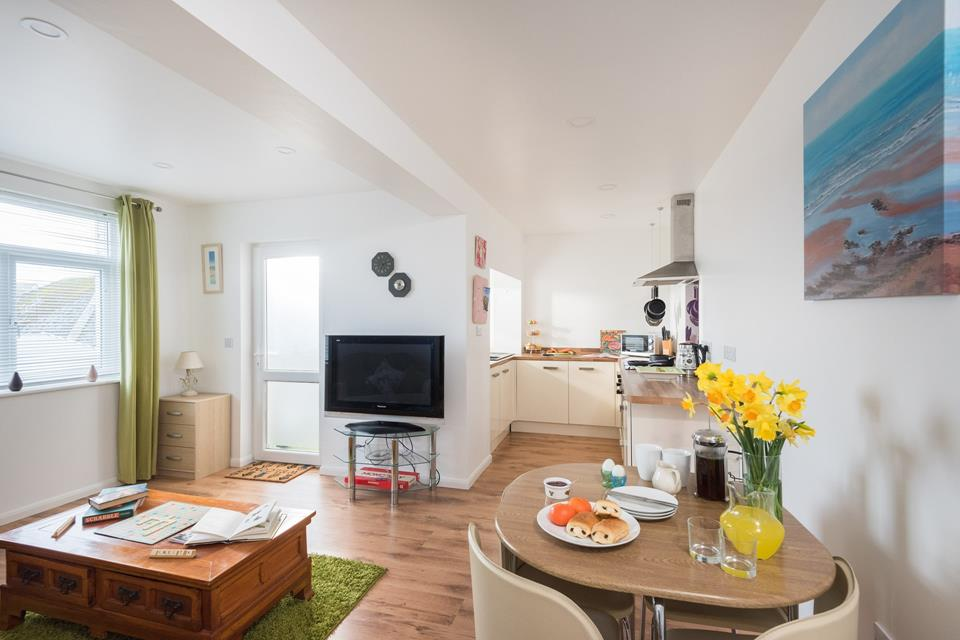 The open plan sitting/dining/kitchen area, is great for catching up over the day whilst cooking up a feast.