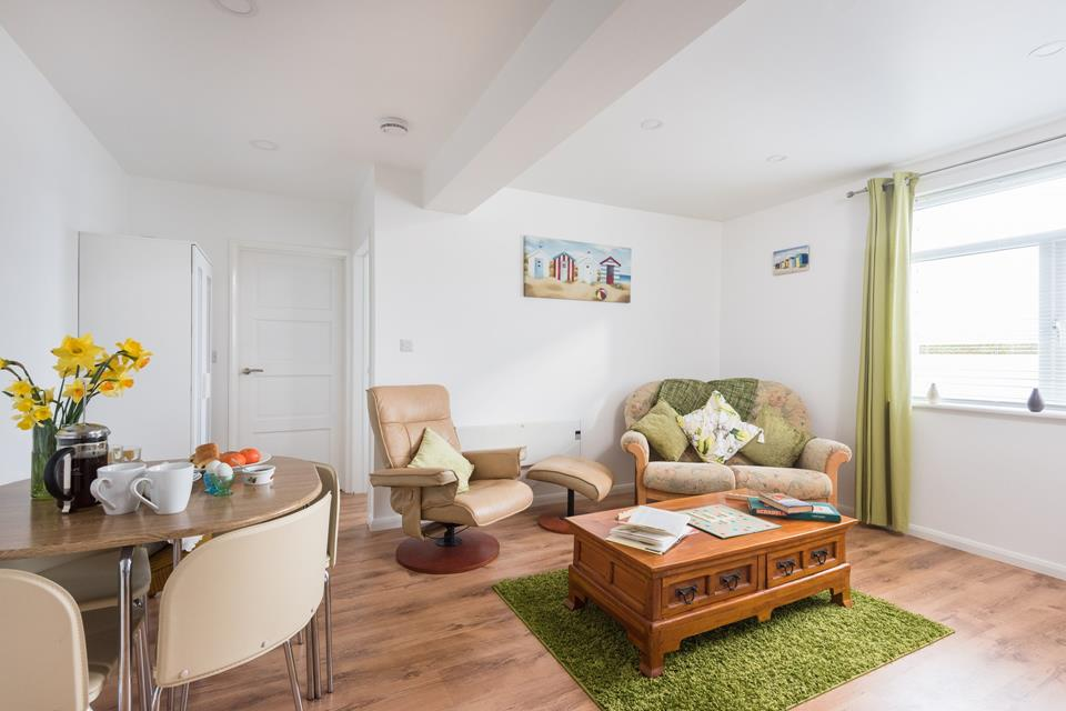 Comfortable sitting/dining area, great for relaxing with a book, board game or a good film.