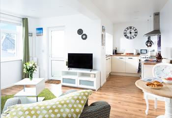 The open plan sitting/dining/kitchen area, is great for catching up on the day's activities.