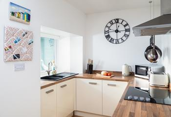 The large window provides plenty of natural light, making the kitchen a bright and airy space