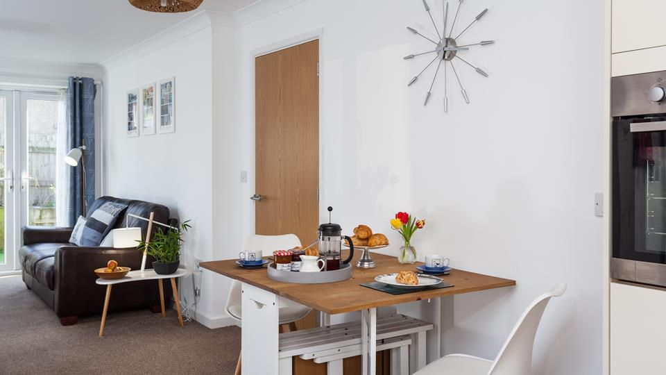 The dining table has fold-able chairs stored underneath making this property ideal for a couple or family break.