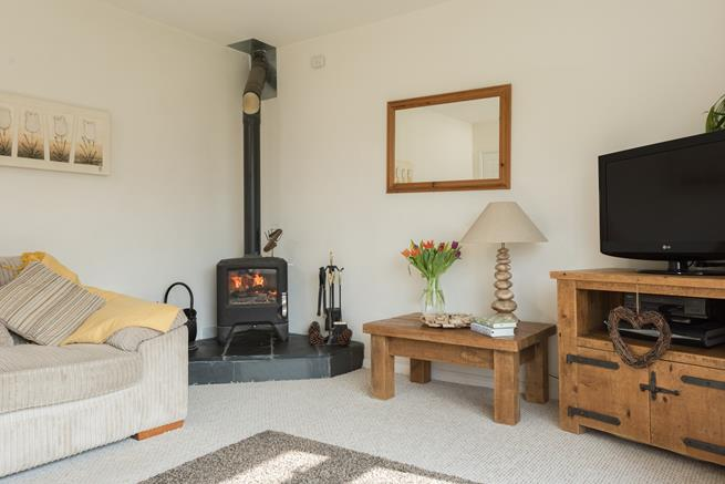 Sitting area with woodburner.