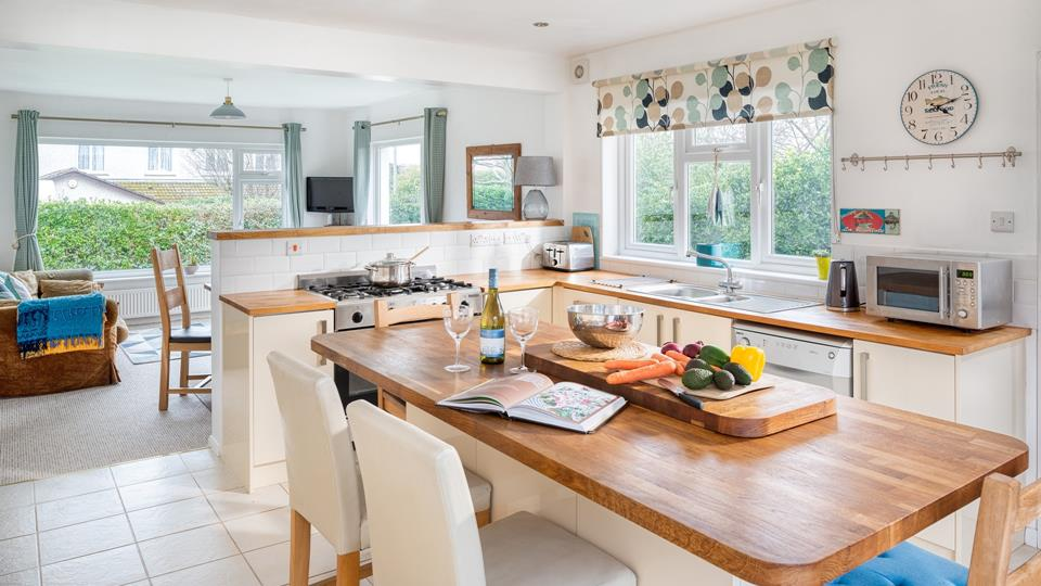 The open plan kitchen and dining area is a great sociable space for planning the days activities.