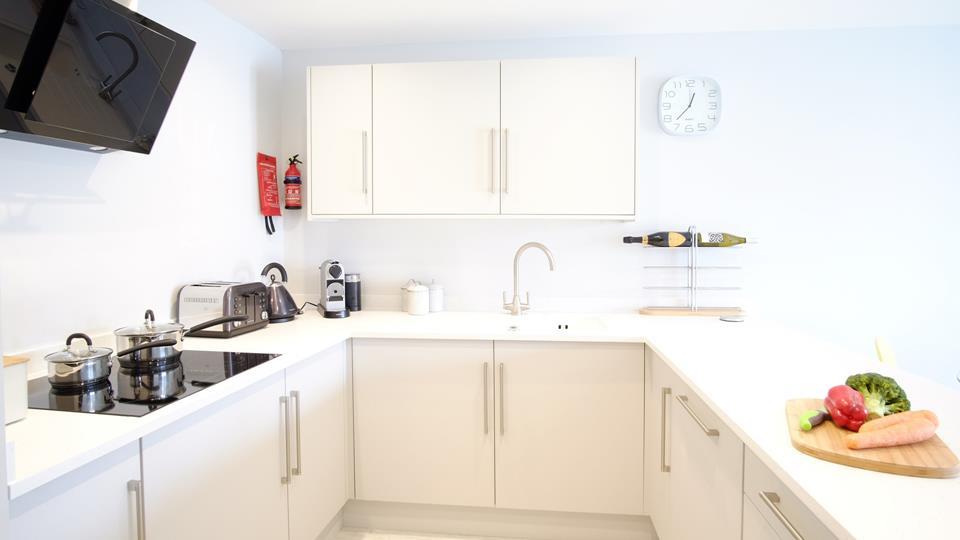 Modern fully equipped kitchen with coffee machine , dishwasher and pop up power points.