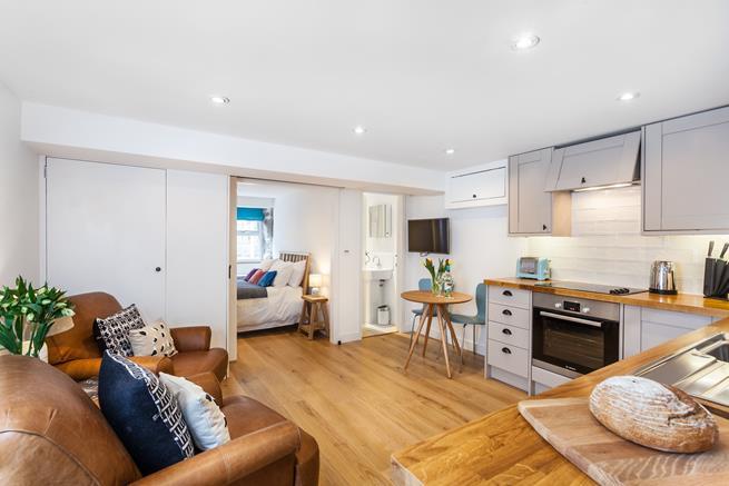 Open plan living room/kitchen.