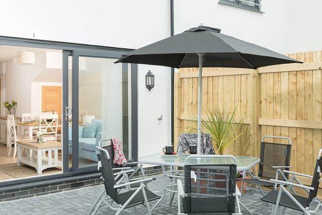 The large, paved garden is a great space for enjoying an evening meal.