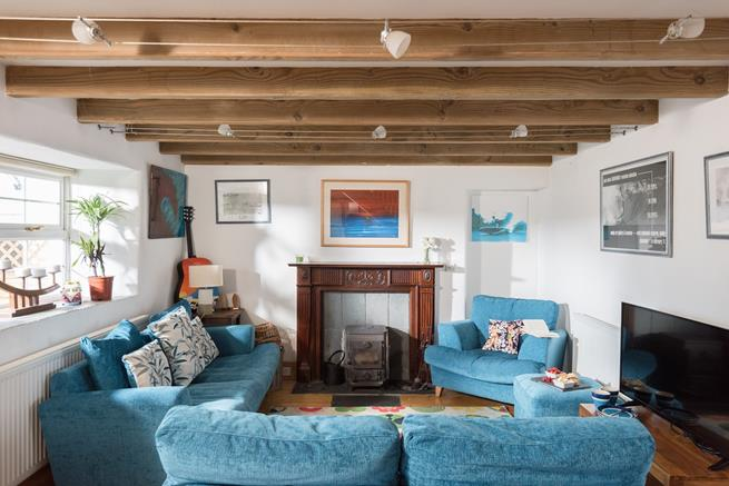 Character beams in the cosy living area.