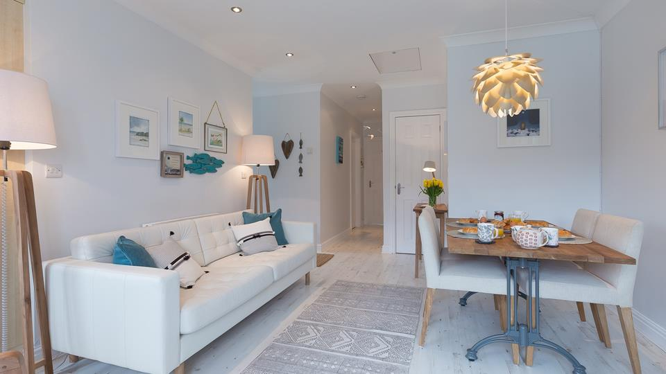 1 Lower Talland Apartment has an open plan living space with limed oak wood effect flooring.