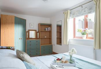 Cute and quirky, the bedroom has plenty of storage space for your belongings and souvenirs you pick up along the way!