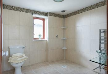 The wet room is spacious and ideal for those with limited mobility. It also benefits from a heated towel rail.