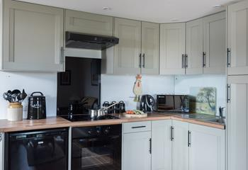 The well equipped, modern kitchen is perfect for cooking up a delicious meal.