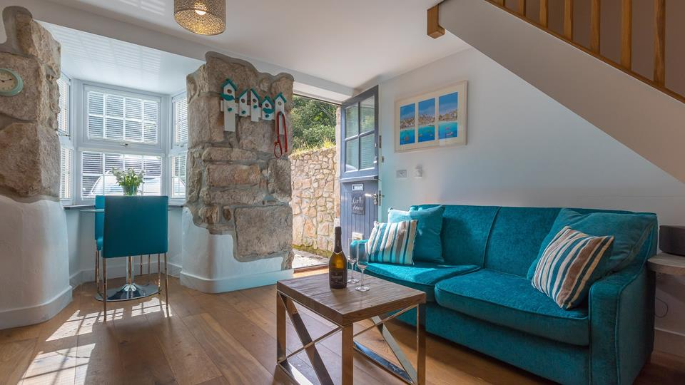 The front door leads into the cosy living area that holds lots of natural light and shades of blue.