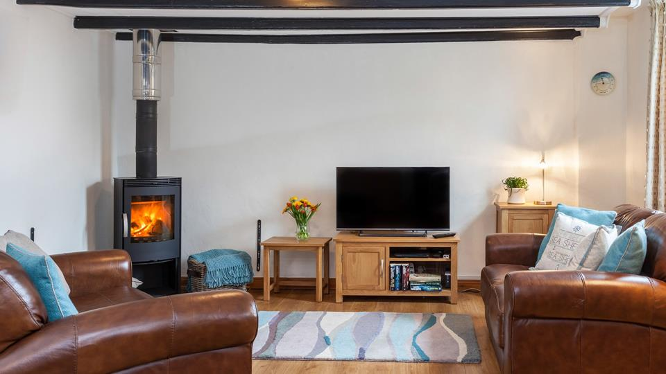 The open plan sitting room with cosy woodburner.