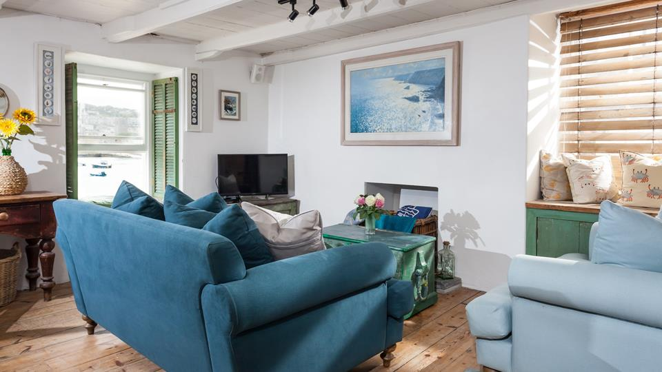 Originally a fisherman's cottage, 1 Quay Street boasts an enviable location right by the beach, making it perfect for a seaside holiday!