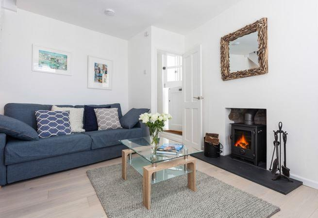 The sitting room is light and cozy, perfect for all seasons
