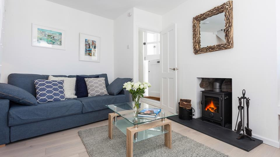 The sitting room is light and cosy, perfect for all seasons.