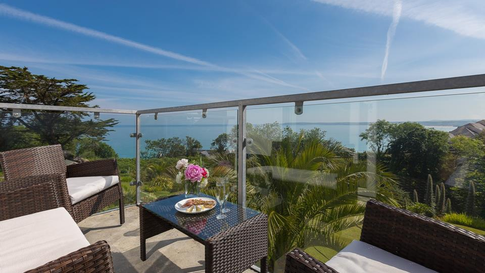 The sunny balcony with views of the gardens and across the bay.