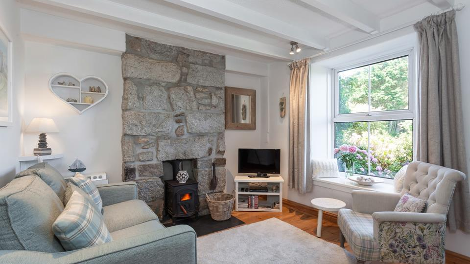 A cosy sitting room complete with a woodburner for the cooler months.