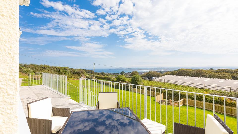 Far-reaching views along the coastline and the ocean from the galvanised metal balustrade terrace area.
