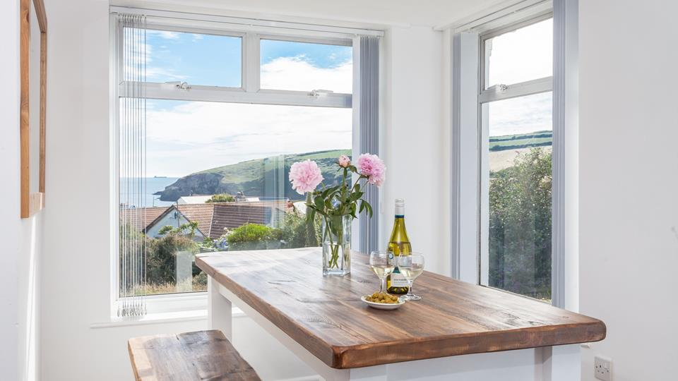 The bench style dining area is surrounded by big windows so you can enjoy a family meal with a beautiful Cornish view.