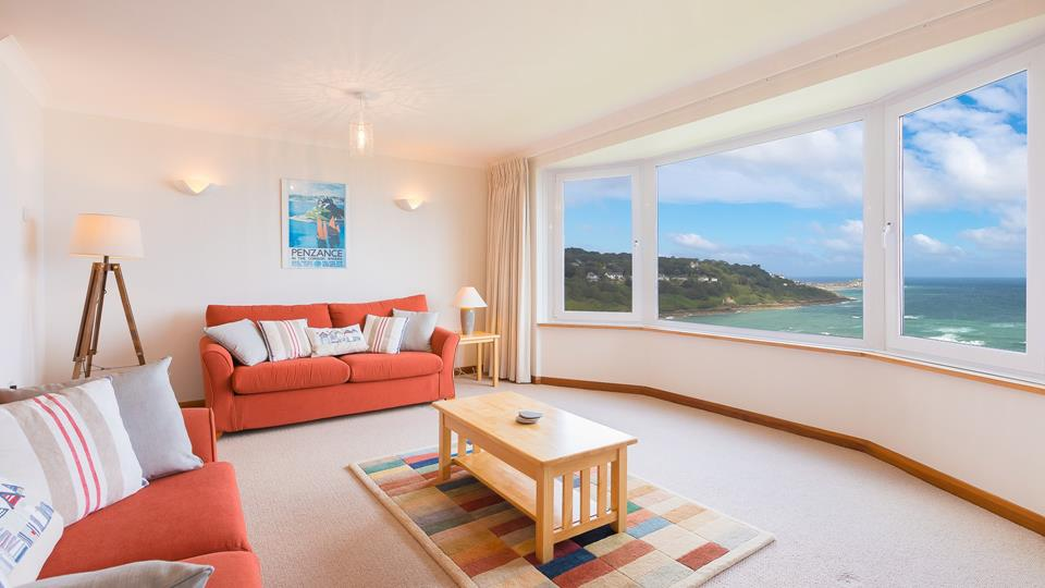 Be mesmerized by picture-perfect sea views through the expansive bay window.