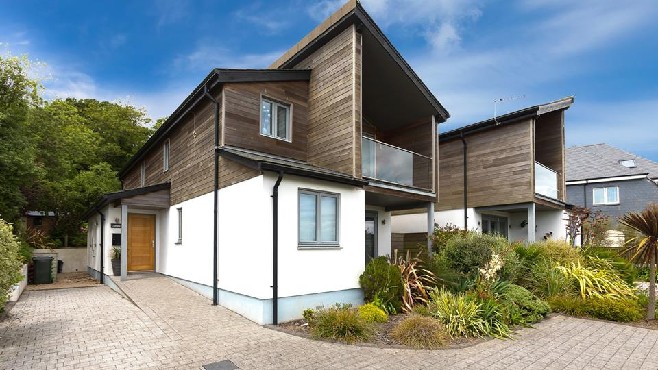 The property is well designed and has partial timber cladding with a balcony overlooking the estuary.