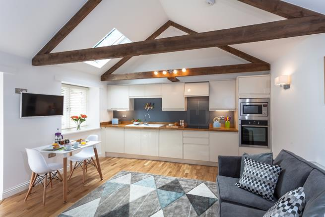 This gorgeous barn conversion has a spacious open plan living area.