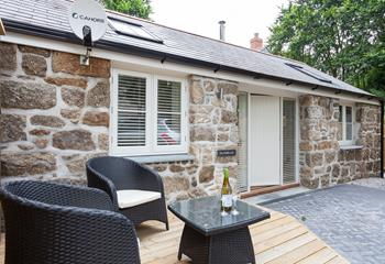The property benefits from parking right outside, with a secluded seating area where you can enjoy a drink in the evening sun.