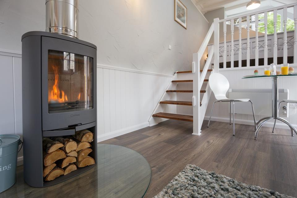 The woodburner provides the cosy barn conversion with a warm glow.