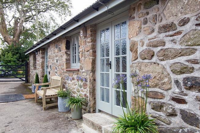Relax outside the property and enjoy your rural surroundings.