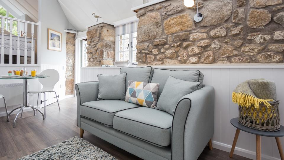 The cosy sitting room has been designed with comfort in mind.