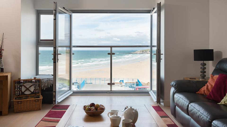 The open plan living area has unbeatable views of Fistral beach from the Juliet balcony.