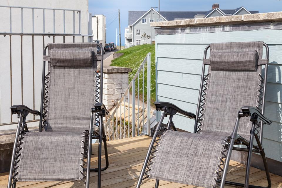 Upper level decking area which is perfect for sunbathing and chilling