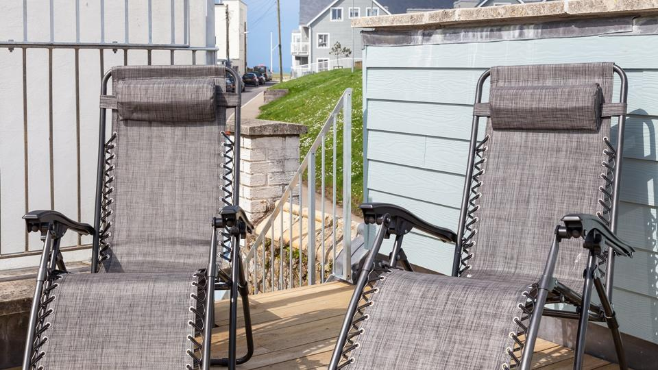 The upper-level decking area is perfect for sunbathing, chilling and making the most of those lovely summer nights and has lounger sun chairs.