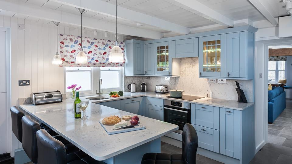 this traditional country kitchen, embraces the blue and offers a great social space.
