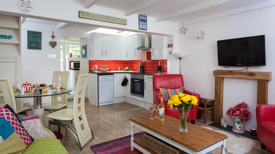 The quaint cottage is uniquely furnished with pops of colour throughout.